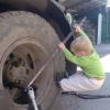 Kid fixes truck wheel