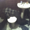 Headless guy in bathroom
