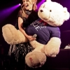 Kylie Minogue playing with teddy bear