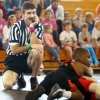 Kids wrestling referee daydreaming